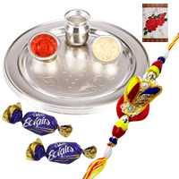 Outstanding Display of Silver Plated Rakhi Thali with Zardosi Rakhi and Chocolates along with Free Roli Tikka for the Occasion of Raksha Bandhan<br> <br>
