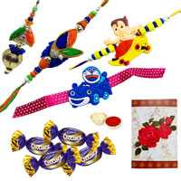 Arresting Collection of Bhaiya Bhabhi Rakhi, 2 Kids Rakhi N 4 Chocolates with Roli and Tilak on Raksha Bandhan