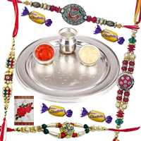 Spectacular Arrangement of Silver Plated Thali N Four Chocolates with Four Rakhi, Roli and Tilak for Rakhi Celebration