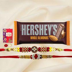 Exquisite Rakhi Pair with Hersheys Kisses Chocolates