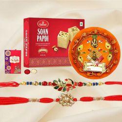 Elegant Pair of Rakhi with Puja Thali N Haldiram Soan Papadi