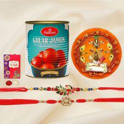 Splendid Set of 2 Rakhi with Gulab Jamun n Puja Thali