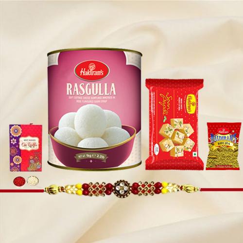 Elegant Rakhi with Sweets and Snacks from Haldiram
