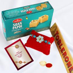 Sweet Gift of Soan Papdi and Toblerone with Rakhi