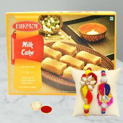 Fancy 2 Rakhis with Yummy Milk Cake N Free Roli Chawal N Rakhi Card
