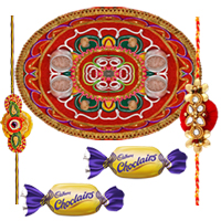Stunning Present of Decorative Rakhi Thali, One Designer Rakhi and Two Tasty Chocolates with Free Roli and Tilak for your Beloved Brother