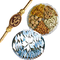 Wonderful Rakhi Gift Pack of Assorted Dry Fruits and Kaju Katli along with Om Rakhi and free Roli and Tikka for your Loving Brother<br>