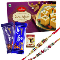 Exquisite Festive Favorite Sweets N Chocolate Gift Hamper with Two Rakhis With Free Rakhi Card