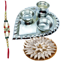 Delicious Kaju Katli from Haldiram and Stylish and Trendy looking Silver Plated Paan Shaped Puja Aarti Thali (weight 52 gms) along Rakhi