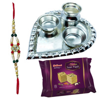 Soan Papri from Haldiram and Stylish and Trendy looking Silver Plated Paan Shaped Puja Aarti Thali (weight 52 gms) along Rakhi
