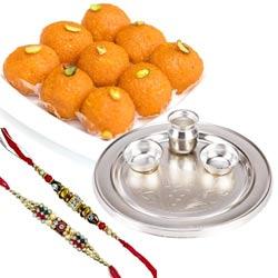Delectable Haldirams Ghee Ladoo with Silver Plated Pooja Thali N Dual Rakhi Set