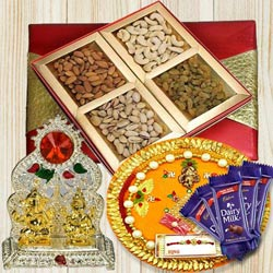 Assorted Dry Fruits with Rakhi Pooja Thali, Ganesh Idol N Chocolates