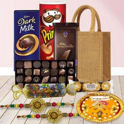 Rakhi Gift Bag of Pooja Thali and 2 pcs Om Rakhi