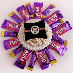 Pious Om Rakhi with Cashew Tray n Cadbury Chocolates