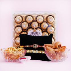 Lovely Golden Rakhi Pair with Ferrero Rocher n Snacks