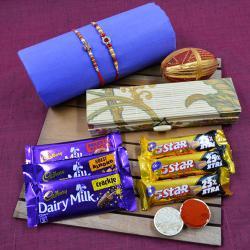 Dazzling Stone Rakhi Set N Cadbury Assortments in Bamboo Box