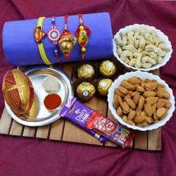 Fancy Family Rakhi Set with Puja Thali, Dry Fruits n Chocolates