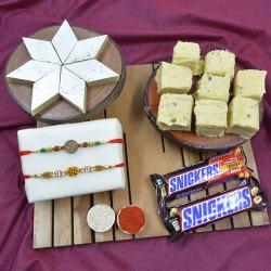 Pious Swastik Rakhi with Haldiram Sweets N Imported Snickers