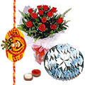 250 Gms. Kaju Katli and 12 Red Roses with Free Rakhi, Roli Tika, Chawal